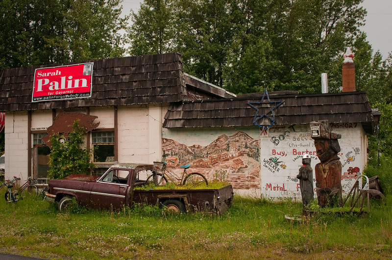 No political statements intended.  This small building in the rural Mat-Su Valley seemed to be almost a tribute to days gone by...from the old cars to the dated political signage.