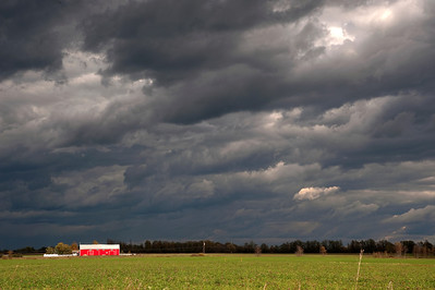 Moody Sky and Red Barn