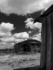 """Shed Wall and House"" - Eddy County, New Mexico."