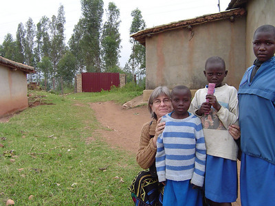 I am with a few Rwandan children as we visit an HIV/AIDS clinic in the surrounding country.