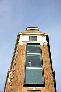 Wide Businessman in window RX100928