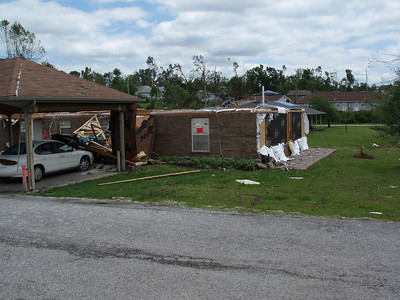 4 – Damaged Structure - Unsafe (Red Unsafe placard on building posted by SAVE Volunteer)