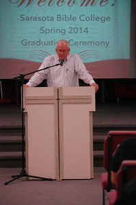 Pastor Don Lafler closing the ceremony in prayer for the students.
