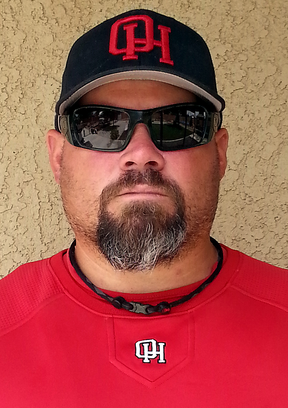 Description of . Jason Story has been named Coach of the Year to The Sun's All Area baseball team. Story coaches the baseball team Oak Hills High School. Courtesy photo to The Sun.