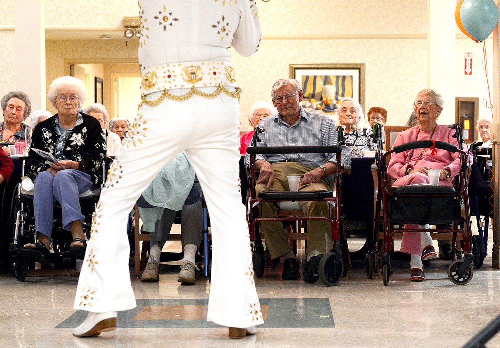 Description of . Elvis impersonator John Gilpin perform for the residents at Heritage Court Assisted Living as they celebrate what would be Elvis' 78th birthday with a party in Upland January 8, 2012. (Staff photo by Thomas Cordova)