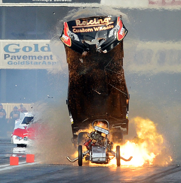 . Funny car driver Tony Pedregon explodes his engine and the body off his hot rod as he races against Todd Lesenko during qualifying Friday February 15, 2013 at the 53rd annual NHRA Winternationals in Pomona. (Staff photo by Will Lester)