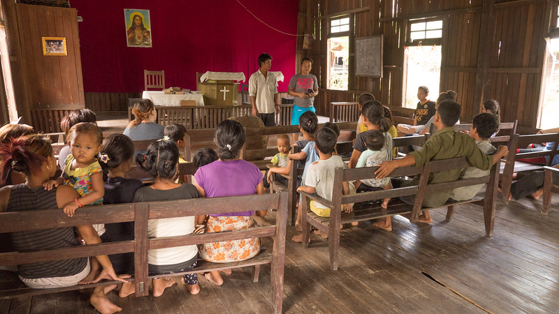 The church has nine families.  Pastor Puia translates for the church pastor.
