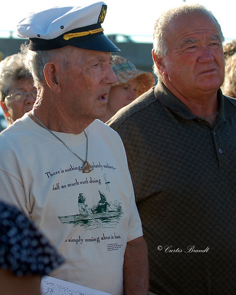 """Captain's Meeting - Blessing of the Fleet<br /> Captain Arthur Daniels, Jr.  89 years young on August 24th, 2010 along side a son.<br /> He has raced in 50 of the 51 races to date - Setpember 2010.<br /> <br /> He became the Captain of the skipjack """" City of Crisfield """" at the age of 21 and remains to this day, Sept 4th, 2010."""