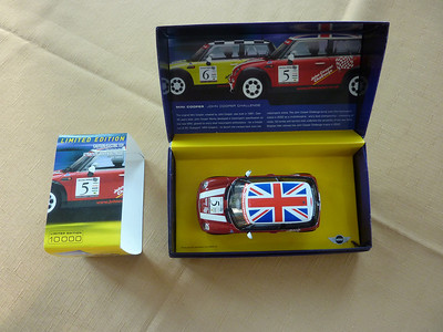 Well, I have the plastic cover, not sure why I left it out in this photo of box, car, plastic cover, and sleeve!  :)