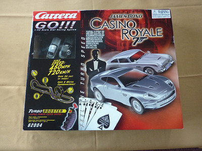 $65.00 buys you this very collectible CARRERA Casino Royale set.   This set includes two beautiful Bond Aston Martin cars. Photo shows many of the features, layouts, Turbo Boost. THIS IS A 1:43 set. Everything else I'm selling is the LARGER 1:32 scale. So, if you have less room but still want to go 720 Km/H...well, here you go! Let the Bond in you loose this Christmas! Photos of inside of box and cars follows.