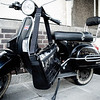 Saxby_hanging_from_vespa