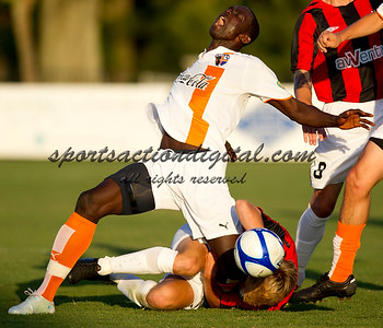 Sallieu Bundu of the Charlotte Eagles is taken down from behind during a game against the Charleston Battery.