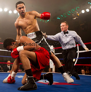"Miguel ""silky smooth"" Gonzales knocks down Ramon Guevera during the undercard of the Holyfield Williams fight at the Greenbrier Resort"