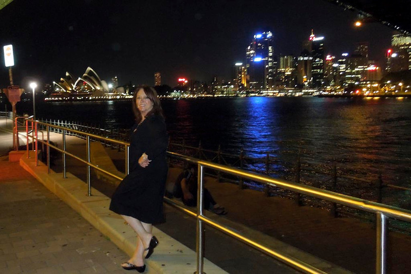 Susan adorning the railing under the Sydney Harbour bridge at Milsons Point. The Opera House and Circular Quay in the background.