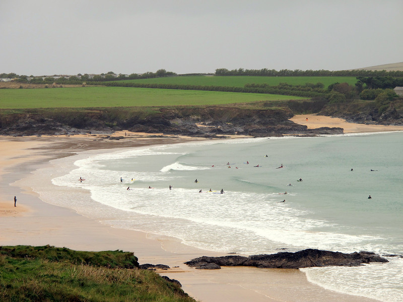 Harlyn Bay.   Surfers (looking like so many stranded flies) attracted by the rising sea.   Surfing seems to involve lots of floating about waiting for the ideal wave to come and then missing it!