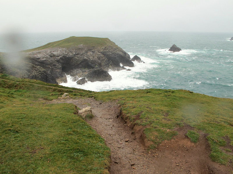 A wild seascape, howling wind and pouring horizontal rain at Trevose Head.