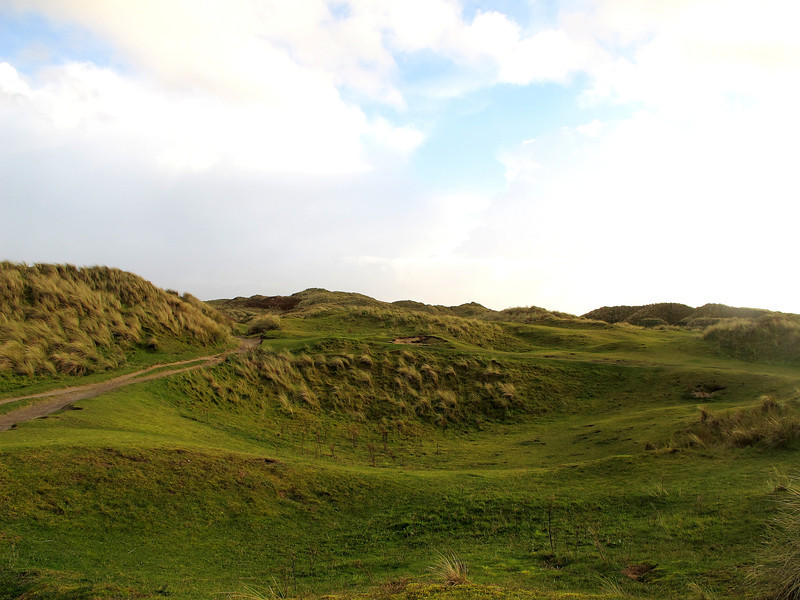 """Under these sand dunes (Towans in Cornish) lie the remains of what was one of the worlds largest explosives factories during the First World War, and was in use until 1945.<br /> See here for more information :- <a href=""""http://en.wikipedia.org/wiki/The_Towans#National_Explosives_Works"""">http://en.wikipedia.org/wiki/The_Towans#National_Explosives_Works</a>"""