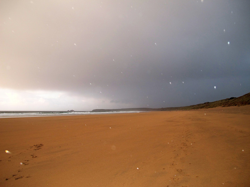 Either rain or hail drops catch the light from the camera flash as the squally wind blows along the beach (the wrong way!) heading for Hayle.