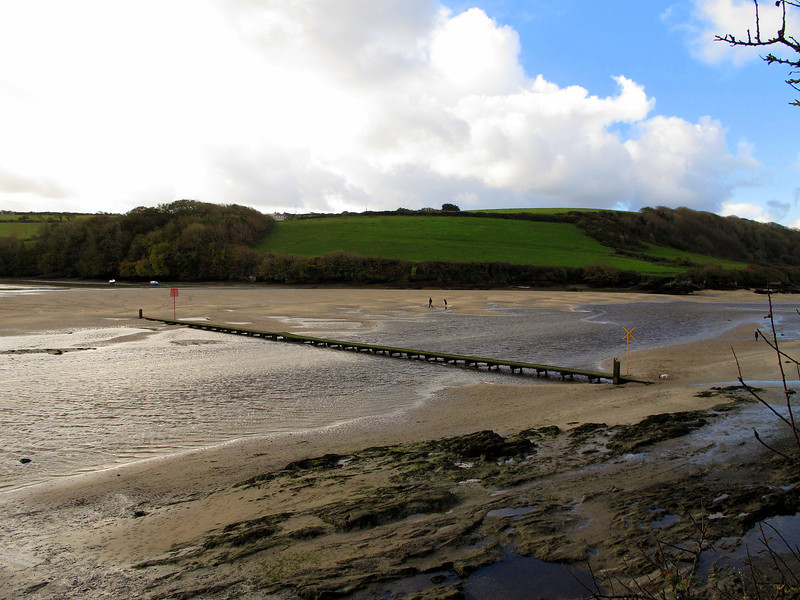 The Coast Path crosses this footbridge from Newquay across to Penpol.   Timing and a knowledge of the tides is required because this bridge is under water through high tide, requiring a lengthy detour upstream to the next bridge over the Gannel river.