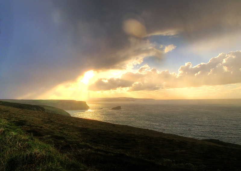 A burst of late afternoon sun lights the way towards Portreath, the destination today.