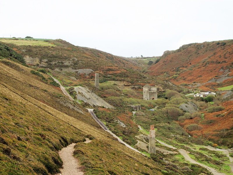 This is an area of old tin mines and other mineral workings.   The old Engine Houses (which housed the steam powered beam engines used for pumping out water) and other industrial buildings are part of the UNESCO Cornwall and West Devon Mining Landscape World Heritage Site.