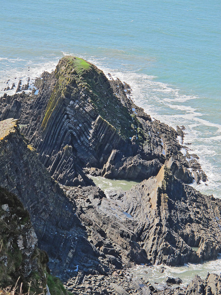 Incredible upheavals have moulded the rock over time on the back of Gull Rock
