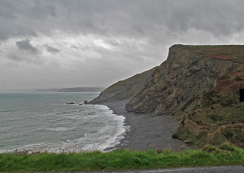 Brooding cliffs under scudding skies at Wanson Mouth.
