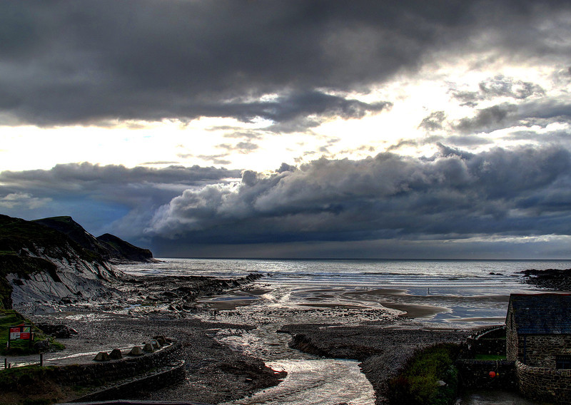 Dramatic evening skies at Crackington Haven.   The wind has abated, the rain has stopped and some late watery sunshine shines through the clouds.   This is the view from the bedroom balcony.