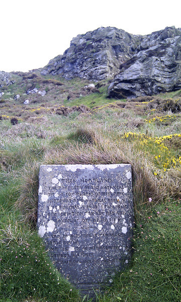 An inscribed stone at Barras Nose headland near Tintagel<br /> marks the first English coastal acquisition by the National Trust in 1896.<br /> The inscription reads :-<br /> <br /> THIS HEADLAND<br /> the property of the National<br /> Trust for places of historical<br /> interest and natural beauty<br /> was purchased in 1896 by public<br /> subscription for the use and<br /> enjoyment of the nation.<br /> <br /> Dorset writer Thomas Hardy is responsible for what follows :-<br /> <br /> 'Hard by was great Tintagel's table round<br /> and there of old the flower of Arthur's knights<br /> made fair beginning of a nobler time'