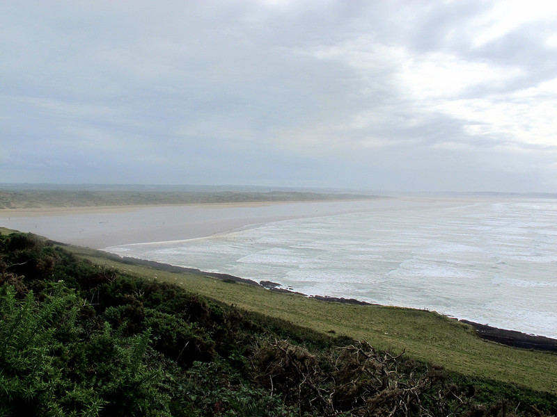 ... and on to Saunton Sands.   A magnificent 3.5 mile sweep of sand backed by acres of large grass covered sand dunes.   The high cloud swept away by the wind from right to left leaving a bright sunny day.