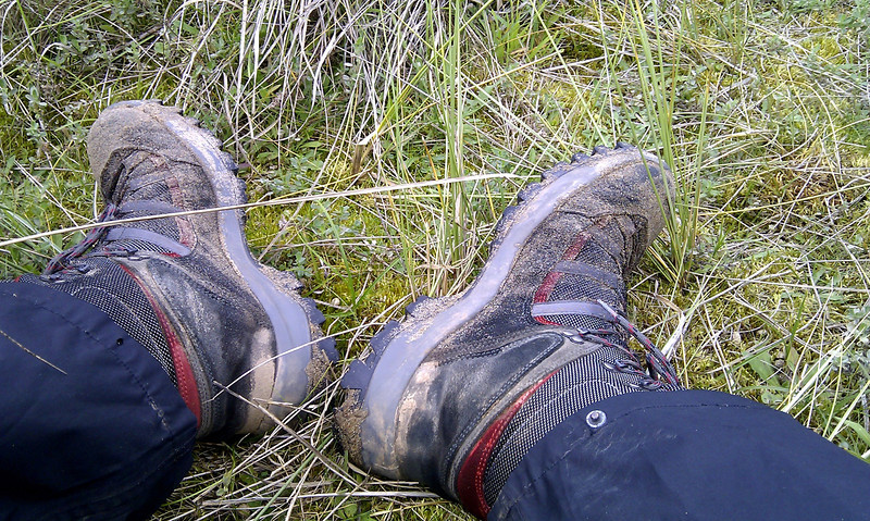 Two weary feet take a breather in the dunes half way up Saunton Sands.