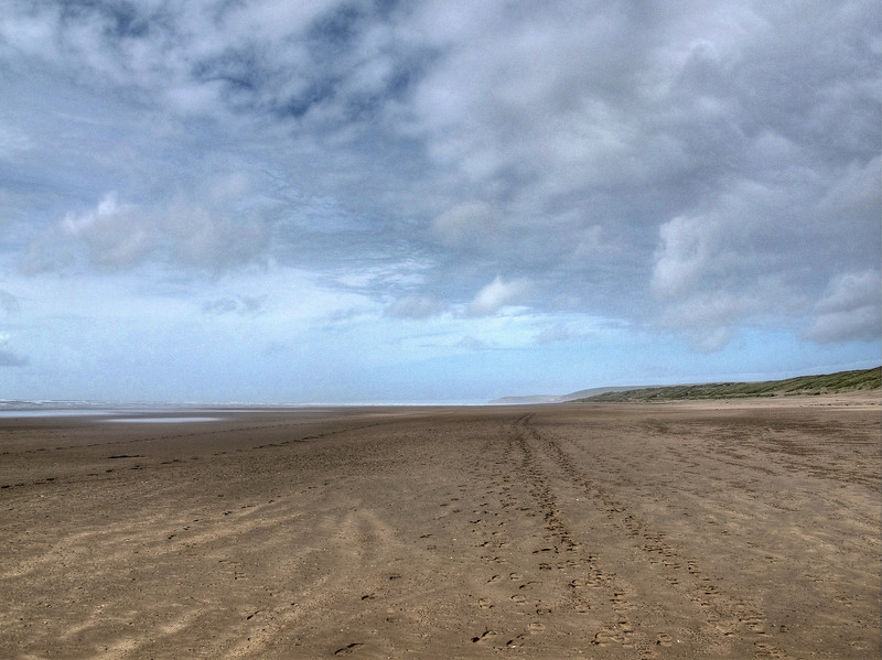 The footpath tracks along the beach seeming to go on for ever.