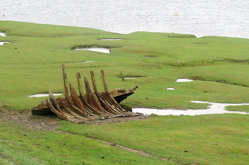 Wrecked boats litter the marshes at Venator on the way to Braunton.