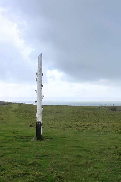 Baggy Point wreck post, which was used in coastguard training exercises to simulate the mast of a ship.<br /> Baggy Point is very different in character from Morte Point. On Baggy, the path climbs higher as one nears the Point, with vertical cliffs dropping precipitously away, until suddenly the end of land is reached with the sea way below.