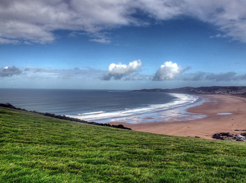 The wide sweep of Woolacombe Beach in Morte Bay - popular with surfers at the near end.