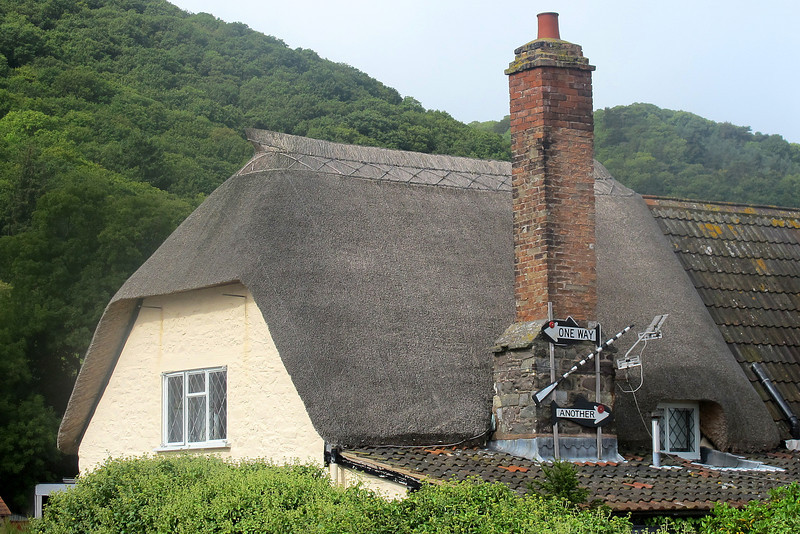 A cottage at Porlock Weir - note the message on the chimney.