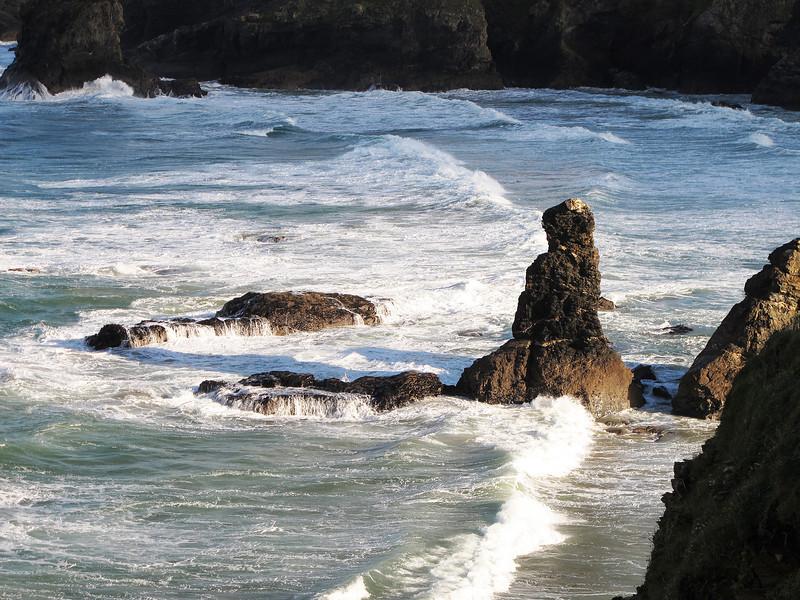 Disturbed seas break over Trescore Islands near the entrance to Porthcothan Harbour.