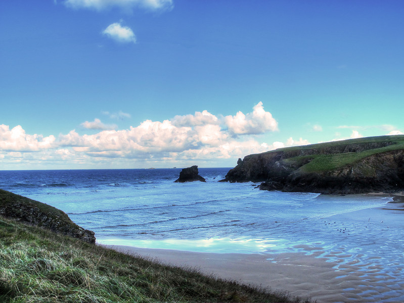 The mouth of the bay at the rear of which lies Porthcothan.
