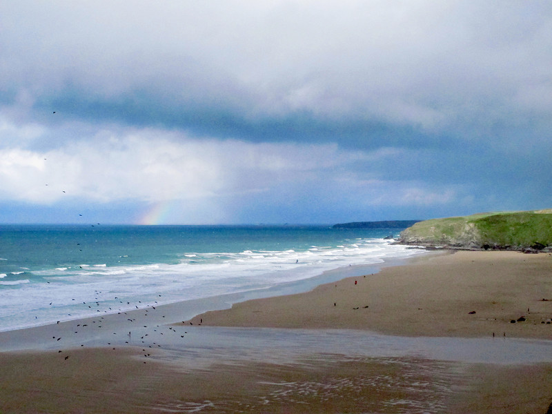 The squall has gone now, and the remains of a rainbow is on the horizon.   Enough time remains to walk the rest of the way into Newquay to dry out before arriving at the B&B.