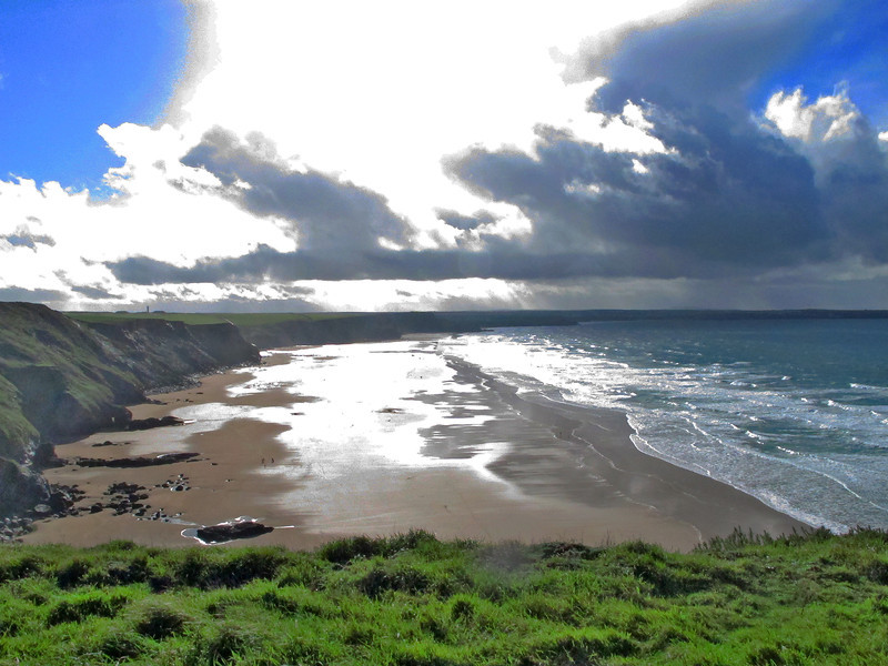 Looking across Watergate beach in the direction of Newquay, not yet visible.   The squall out to sea was heading this way!