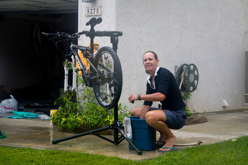 Jen cleaning her mountain bike after a month of hard core riding in the US!