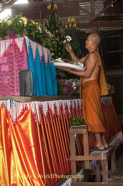 Monk Places Flowers On Truck