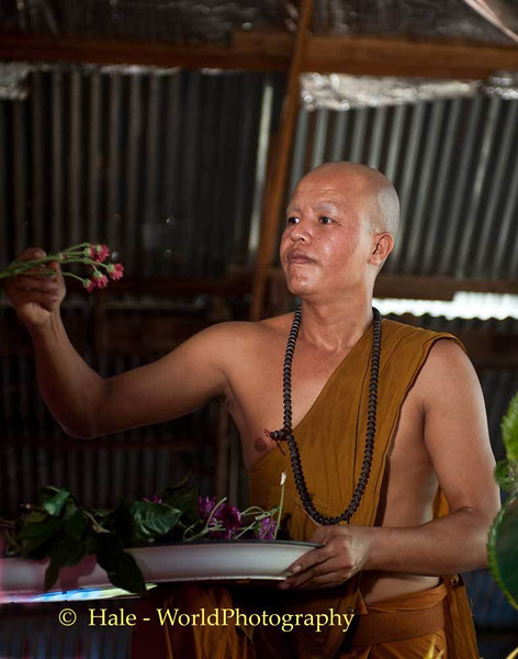 Monk Adding Flowers to Decorate Truck
