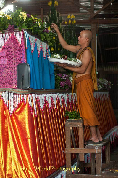 Monk Placing Flowers On Truck