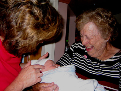 gramma sue & gramma patty hold baby sally.