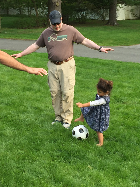 Granddaughter taking grandpa to school on soccer