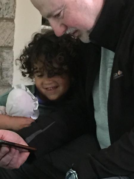 Grandpa entertaining Sami on iPhone