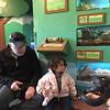 Sami at Greenburgh Nature Center, petting many animials, including snakes