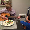 Matt gives Coby guitar lessons