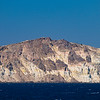 colored cliffs of Santorini with lighthouse